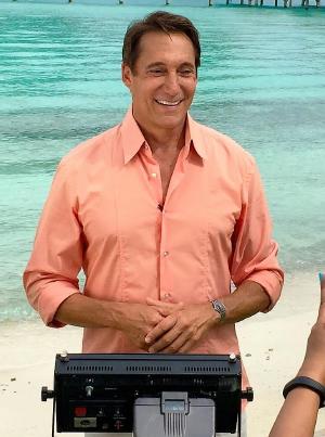 Michael Corbett on set in front of ocean